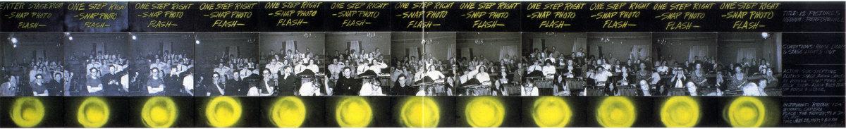 """Abb. 2 Vito Acconci: Twelve Pictures, 1969, The Theatre, New York City. Ca. 99 x 660 cm, Fotos aufgezogen auf Schaumkernplatte, Mischtechnik (Präsentation im Rahmen der Ausstellung: """"Vito Acconci. Photographic Works. 1969—1970"""", Rhona Hoffman Gallery, Chicago (8. Januar–6. Februar 1988)/Brooke Alexander, New York (6. Februar–5. März 1988), entnommen dem Ausst. Kat. Vito Acconci. Photographic Works. 1969—1970, Rhona Hoffman Gallery, Chicago (8. Januar–6. Februar 1988)/Brooke Alexander, New York (6. Februar–5. März 1988), New York 1988, o.S.). © Vito Acconci."""